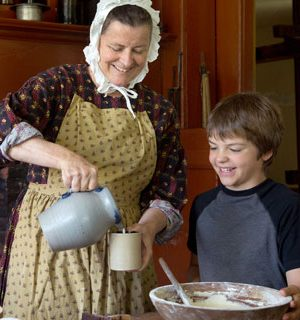 Pouring, stirring, and helping is the role of students at our museum.