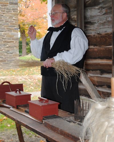 The Farmers' Museum interpreters demonstrate how to process flax, a plant fiber that eventually becomes linen.