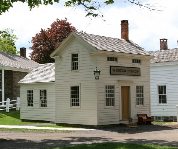 The Westcott Shop at the Farmers' Museum features a broom maker and a fancy weaver.