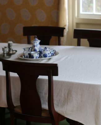 "In 1840 weathier families had a separate room for dining often highlighting the ""best things"" the family owned."
