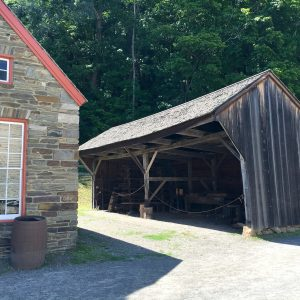 Used for coopering at the Farmers' Museum, this drive shed was once used to house carriages.