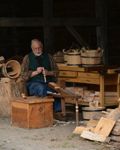 Farmers' Museum interpreter demonstrates the fine craft of coopering- making wooden water tight buckets.
