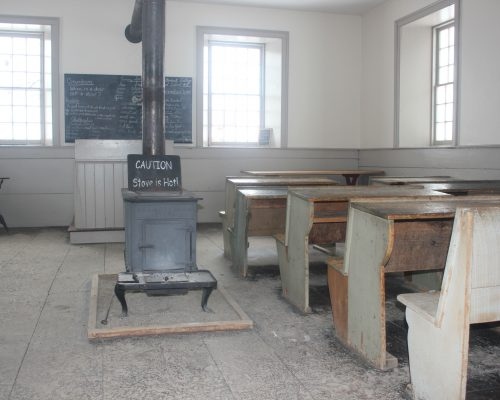 Filer's Schoolhouse has a large central stove that kept students warm in the winter months when the students were more likely to attend school.