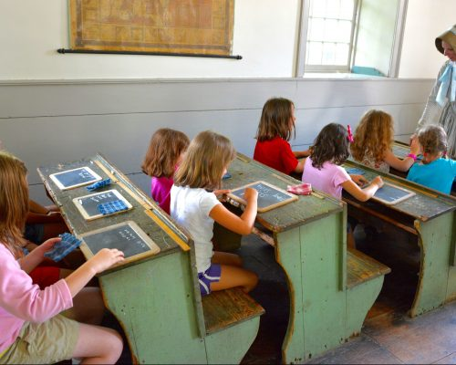 Students visiting the Farmers' Museum experience a lesson from the 1840s, and compare this lesson to what they are taught today.