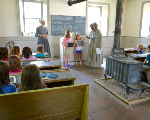 In the 1840s pupils were expected to recite lessons in front of the class. Here visiting students from a local school experience 1840s school.
